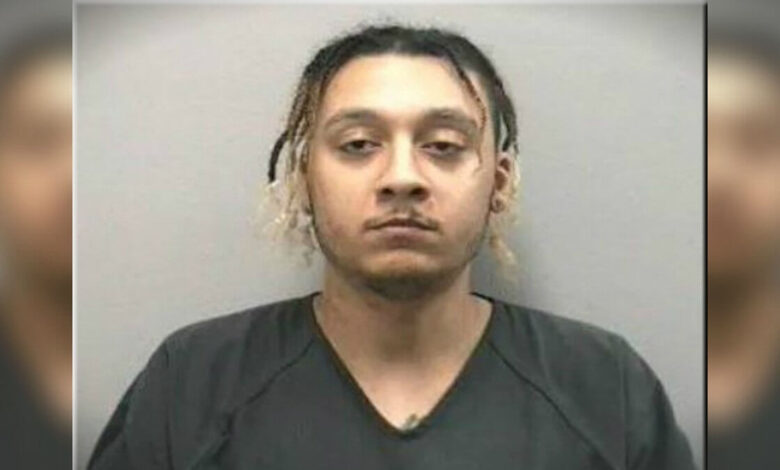 The man who slapped his girlfriend with a cheeseburger and then pushed him down the stairs has been arrested
