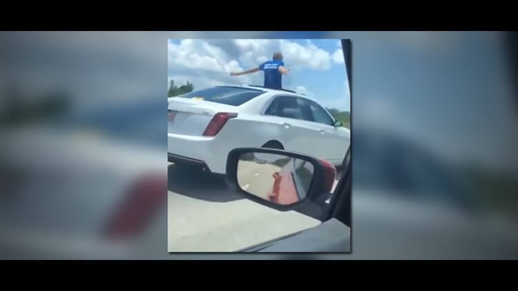 A Florida man driving on Interstate 4 has been spotted on the car's sunroof.