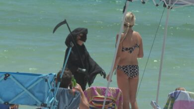A Florida man wears a Grim Reaper suit and wants the governor to make masks mandatory